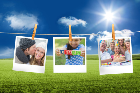 composite image: Composite image of instant photos hanging on a line against field and blue sky Stock Photo