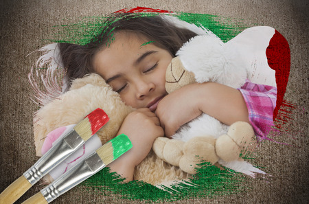 Composite image of little girl cuddling teddys with paintbrush dipped in green against weathered surface  photo