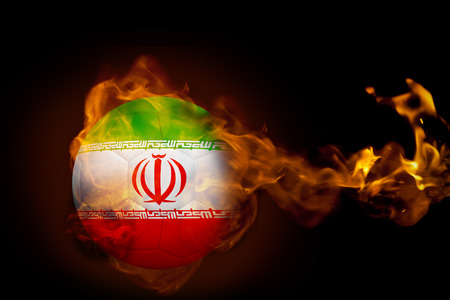 Composite image of fire surrounding iran ball against black photo