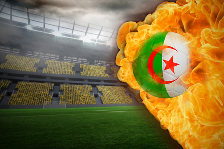 Composite image of fire surrounding algeria flag football against large football stadium with lights photo