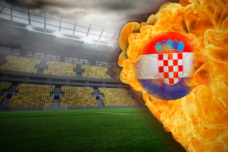 Composite image of fire surrounding croatia flag football against large football stadium with lights photo