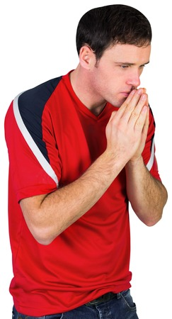 pleading: Nervous football fan in red on white background Stock Photo