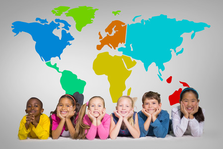 early: Cute pupils smiling at camera against grey vignette with world map Stock Photo