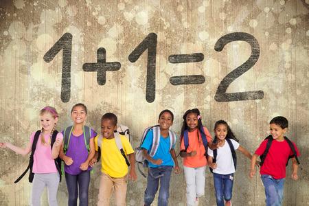 Elementary pupils running against paint splattered paper photo
