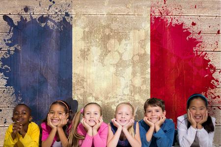 Grunge Camera Effect : Cute pupils smiling at camera against france flag in grunge effect