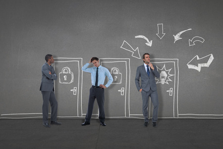 Composite image of business people standing against black wall photo
