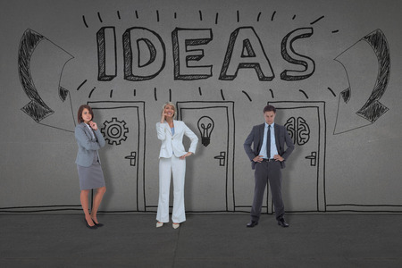 composite image: Composite image of business people standing against black wall Stock Photo