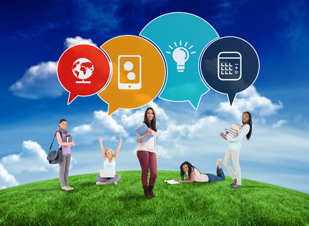 Composite image of happy students with speech bubbles against green field under blue sky photo