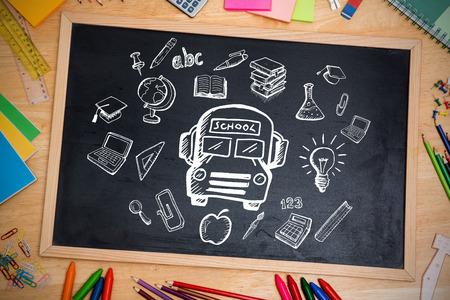 Composite image of education doodles against chalkboard photo