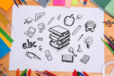 parer: Composite image of education doodles against students desk