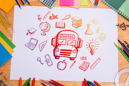 parer: Composite image of education doodles against students desk