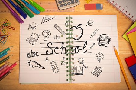 Education doodles against students desk photo