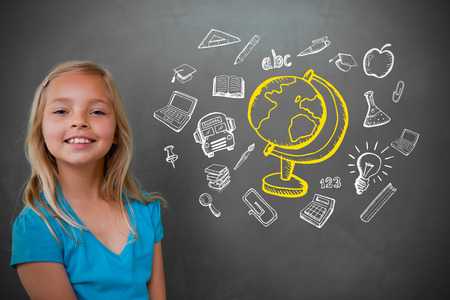 Cute pupil with chalkboard with education doodles photo