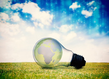 Lines of blue blurred letters falling against earth inside light bulb photo
