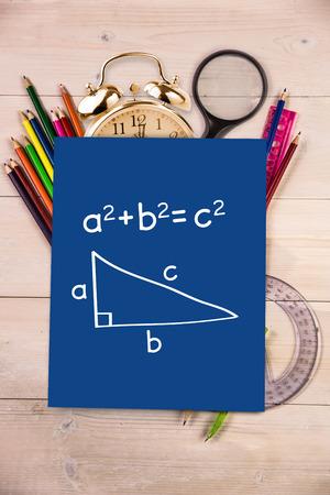trigonometry: Trigonometry against students desk with blue page