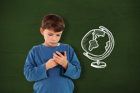 Cute boy using smartphone against green with globe doodle photo