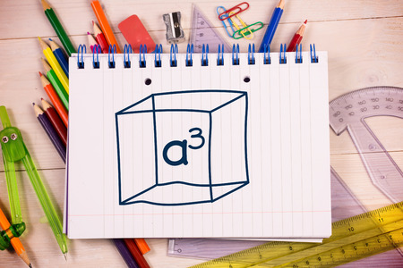 cubed: A cubed on notepad against students desk