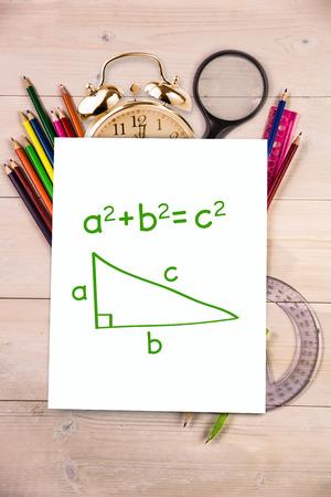 trigonometry: Trigonometry against students desk with white page Stock Photo