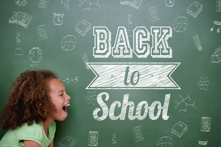 Composite image of back to school message against cute pupil shouting photo