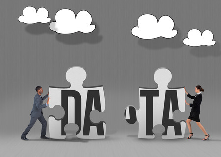 The word data and businessman pushing against grey jigsaw pieces photo