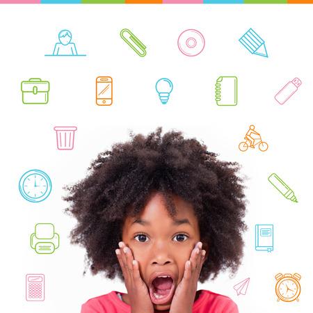 School icons against shocked little girl photo