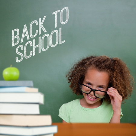 tilting: Cute pupil tilting glasses against back to school message
