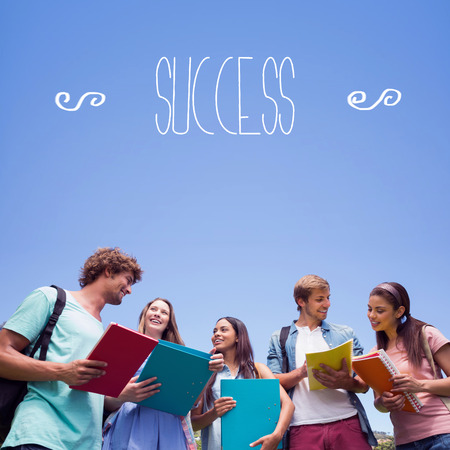 The word success against students standing and chatting together  photo