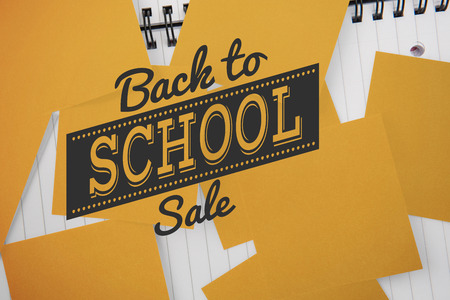 untidy text: Back to school sale message against yellow paper strewn over notepad