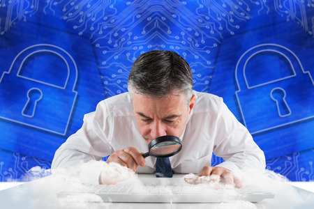 Mature businessman examining with magnifying glass against lock graphic on blue background