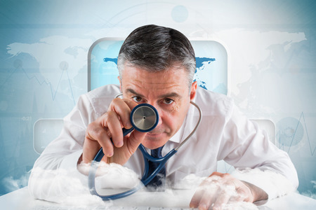 Mature businessman running diagnostics against screen with blue world map photo