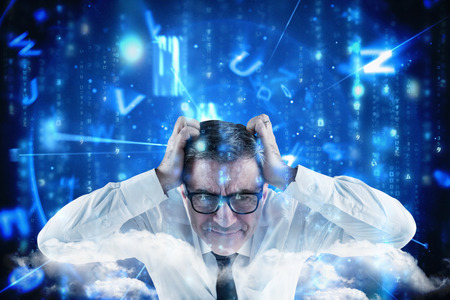 Stressed businessman touching his head against lines of blue blurred letters falling photo