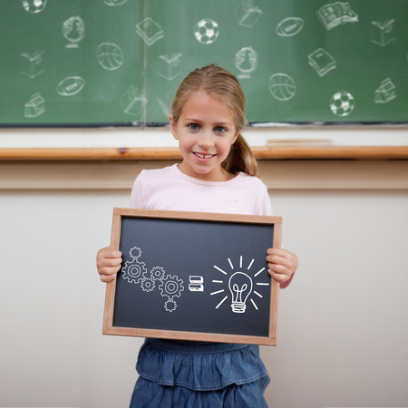 Idea and innovation graphic against cute pupil showing chalkboard photo
