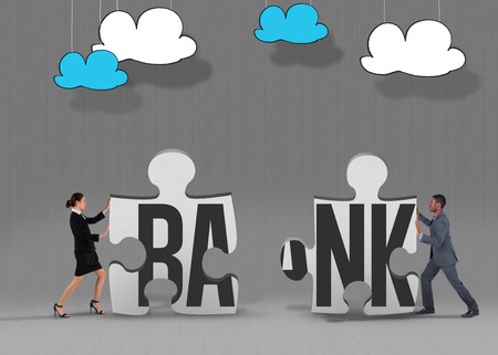 The word bank and businesswoman pushing against grey jigsaw pieces photo