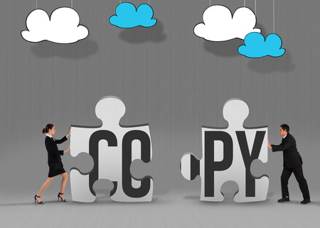 The word copy and businesswoman pushing against grey jigsaw pieces photo
