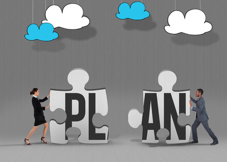 The word plan and businesswoman pushing against grey jigsaw pieces photo