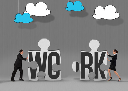 The word work and businessman standing and pushing against grey jigsaw pieces photo