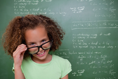 tilting: Cute pupil tilting glasses against rocket science theory