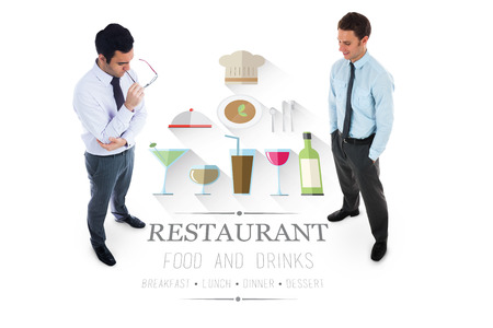 Unsmiling businessman holding glasses against restaurant advertisement photo