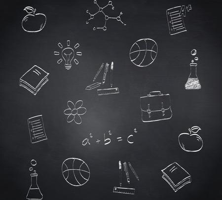 Composite image of school doodles against blackboard photo