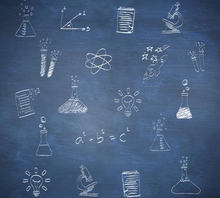 School doodles against blue chalkboard photo