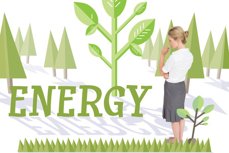 The word energy and thinking businesswoman against forest with trees photo