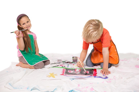 children painting: Happy little children painting on the floor on white background Stock Photo