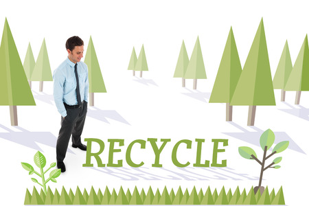 The word recycle and happy businessman standing with hands in pockets against forest with earth tree photo