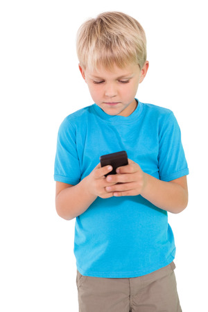 cut out device: Cute little boy using smartphone on white background Stock Photo