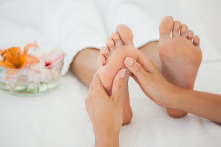 Woman receiving a foot massage at the health spa Zdjęcie Seryjne - 30865984
