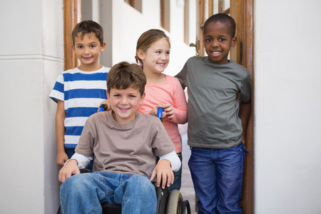 elementary school: Disabled pupil with his friends in classroom at the elementary school