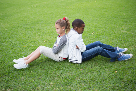 Young friends not talking to each other after fight in the park photo