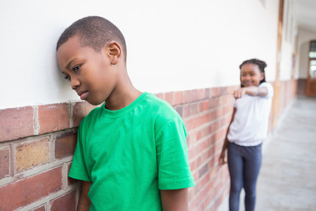 Pupil bullying another in the hall at the elementary school photo