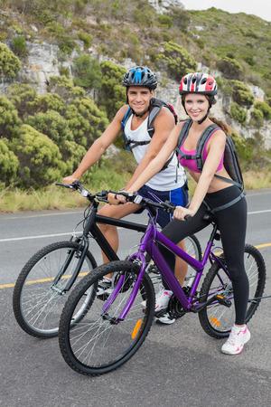Portrait of an athletic couple mountain biking photo