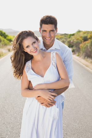 countryside loving: Portrait of a loving young couple standing on countryside road Stock Photo
